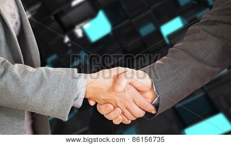 Two people having a handshake in an office against blue and black tile design