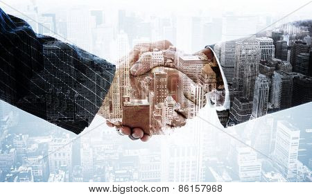 Business people shaking hands against high angle view of city