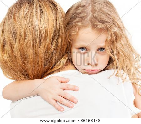 Sad child embracing mother. Girl with female.