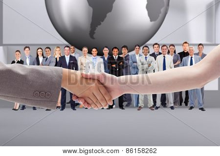 Handshake between two women against planet on grey abstract background