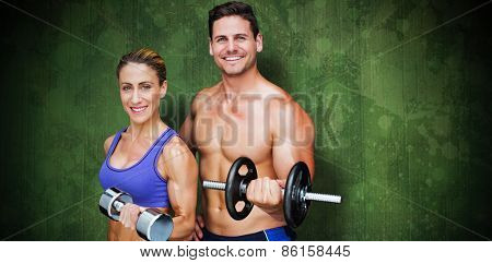 Bodybuilding couple against green paint splashed surface