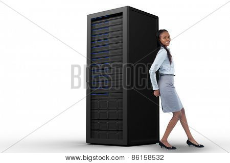 Portrait of a young businesswoman pushing a panel with her back against server tower