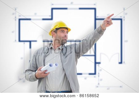Architect pointing against blueprint