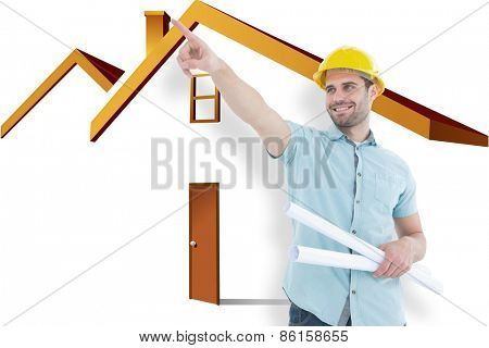 Male architect with blueprints pointing away against house