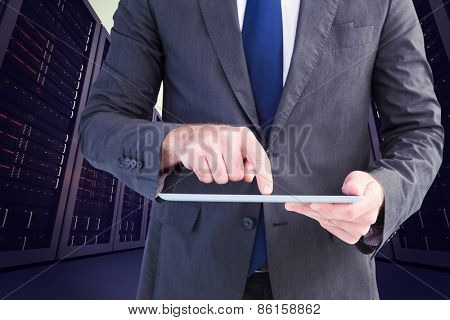 Businessman using his tablet pc against server hallway