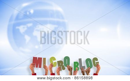 Hands showing microblog against futuristic technology interface