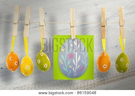 easter egg against bleached wooden planks background