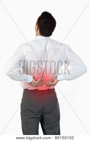 Portrait of the painful back of a young businessman against a white background