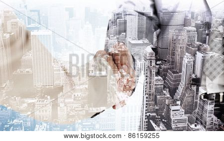 People in suit shaking hands against high angle view of city