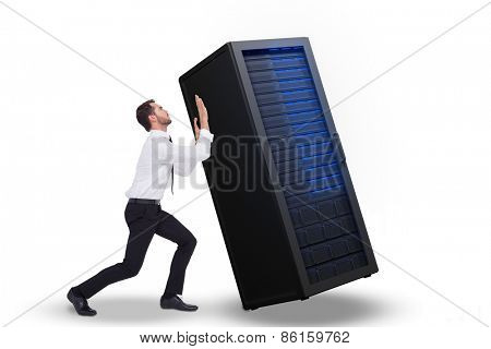Businessman standing with bent legs and pushing against server tower
