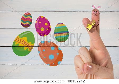 Fingers as easter bunny against painted blue wooden planks