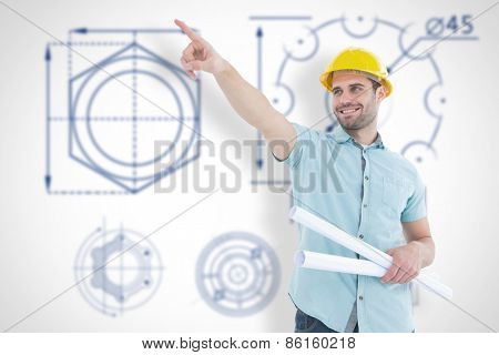 Male architect with blueprints pointing away against blueprint