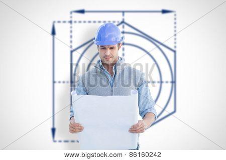 Architect reading blueprints against blueprint