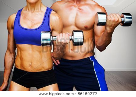 Bodybuilding couple against digitally generated room with stairs