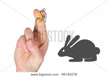 Fingers as easter bunny against easter bunny