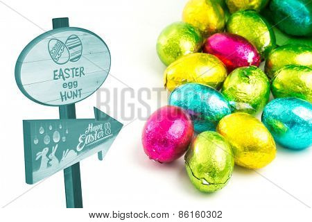 Easter egg hunt sign against colourful easter eggs