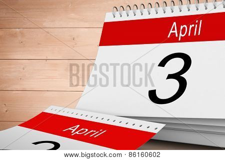 April calendar against overhead of wooden planks