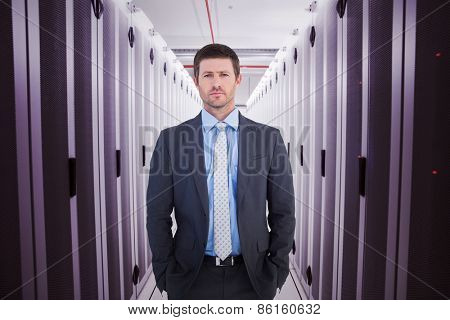 Businessman looking at the camera against data center