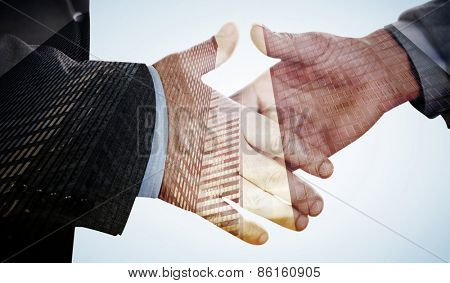 Two people going to shake their hands against low angle view of skyscrapers
