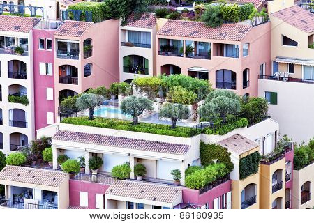 Colorful apartments with roof gardens balconies and patios