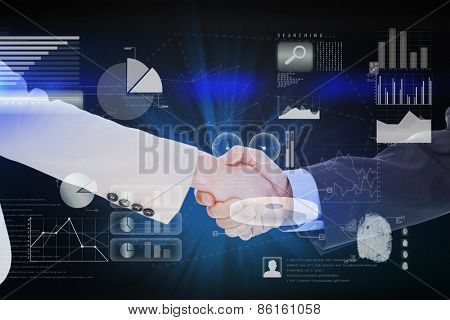 Smiling business people shaking hands while looking at the camera against abstract technology interface