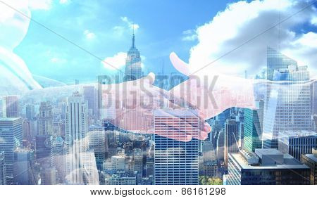 Businessman going shaking a hand against city skyline