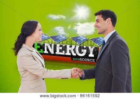 Future partners shaking hands against solar panels in a sunny field in an energy saving battery