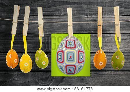 easter egg against overhead of wooden planks