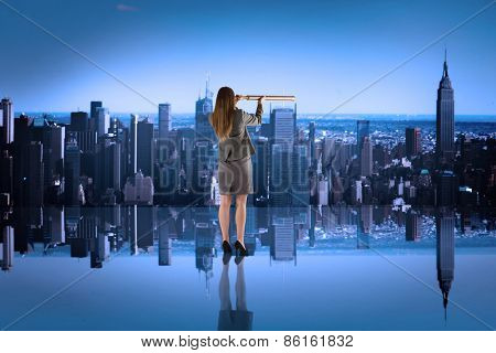 Businesswoman looking through a telescope against mirror image of city skyline