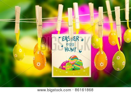 easter egg hunt graphic against pink gift box and yellow tulips
