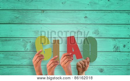 Hands holding up ciao against digitally generated grey wooden planks