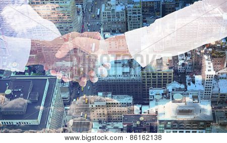 Close-up shot of a handshake in office against new york