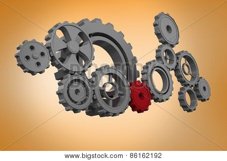 Cogs and wheels against orange vignette