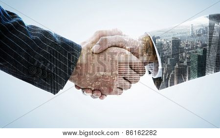 Business people shaking hands against city skyline
