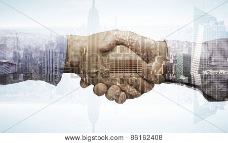 Hand shake against skyscraper