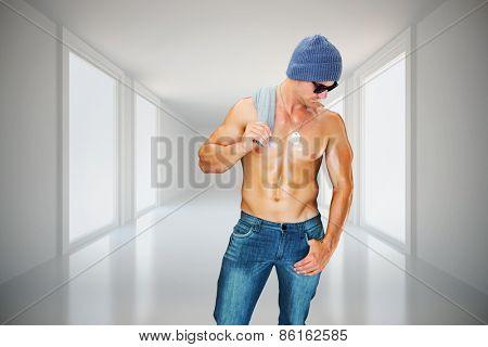 Attractive bodybuilder against digitally generated room