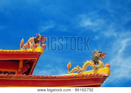Two Dragons On The Roof Of A Buddhist Temple
