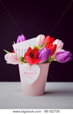 mothers day greeting against tulips with note