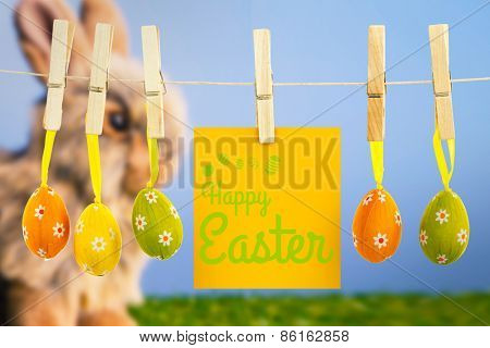 Happy Easter greeting against grey bunny rabbit