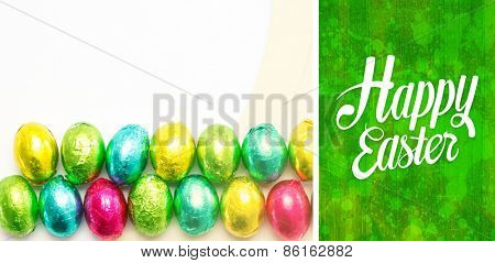 Happy easter against green paint splashed surface