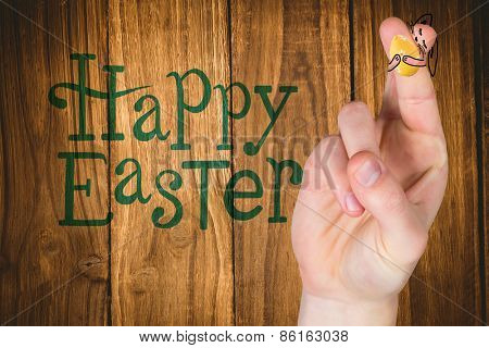 Fingers as easter bunny against wooden table