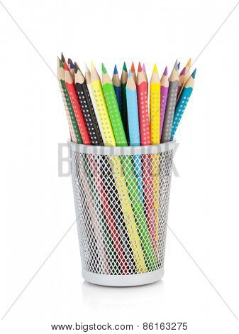Various colour pencils in holder. Isolated on white background