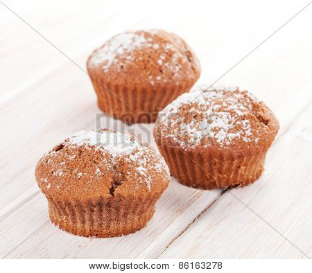 Homemade cakes on white wooden table