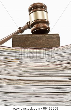 Gavel on pile of documents Slow justice concept