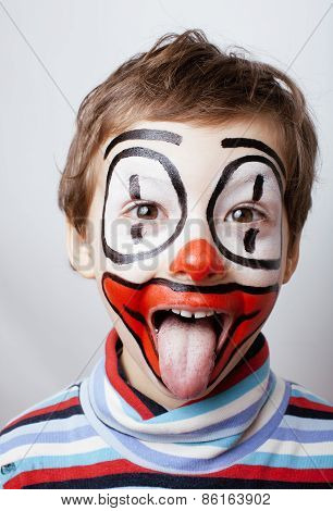 little cute real boy with facepaint like clown, pantomimic
