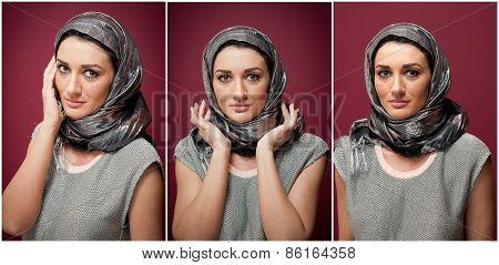 Attractive brunette woman in gray blouse and headscarf posing dramatic on purple background