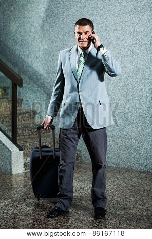 Happy businessman traveling