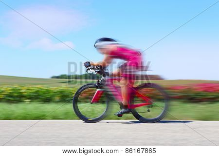 Colorful racing Cyclist. Motion blur.