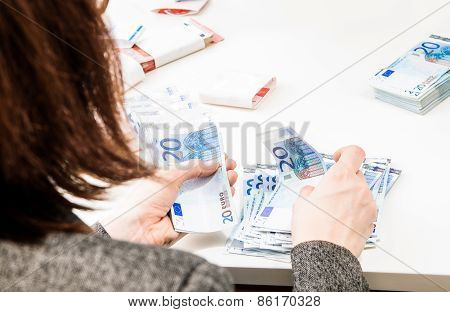 Successful Business Woman Is Counting Money Bills Ona A Desk
