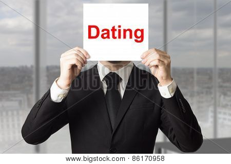 Businessman In Office Hiding Face Dating